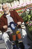 Senior Man On Motor Scooter At Garden — Stock Photo