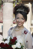 Beautiful Quinceanera Holding Flowers — Stock Photo