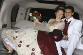 Happy Quinceanera Sitting In Limousine With Partner — Stock Photo