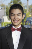 Happy Teenage Boy In Tuxedo At Quinceanera — Stock Photo