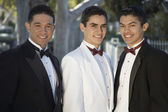 Three Young Men In Tuxedos Standing Together at Quinceanera — Stock Photo