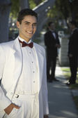 Handsome Young Man In Tuxedo Smiling at Quinceanera — Stock Photo