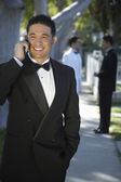 Handsome Young Man In Tuxedo Using Cell Phone At Quinceanera — Stock Photo