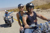 Bikers Riding On Desert Road — Stock Photo