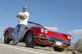 Man Standing Beside Classic Car On Road — Stock Photo