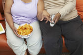 Obese Couple Sitting On Couch — Stock Photo