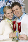 Couple Holding Flutes Of Champagne — Stock Photo
