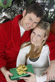 Couple Holding Present Embracing — Stock Photo