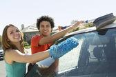 Couple Washing Car — Stock Photo