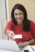 Receptionist Offering Name Tag In Office — Stock Photo
