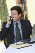 Businessman Communicating On Mobile Phone — Stock Photo