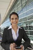 Beautiful Businesswoman Using PDA — Stock Photo