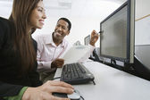 Man And Woman Working Together In Computer Lab — Stok fotoğraf