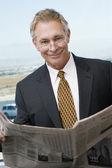 Senior Businessman Reading Newspaper — Stock Photo
