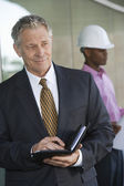 Businessman Holding Dairy With Male Architect — Stock Photo