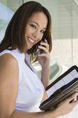Businesswoman On Call Holding Day Planner — Stock Photo