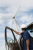 Engineer By Car At Wind Farm — Stock Photo