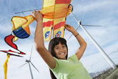 Girl With Airplane Kite At Wind Farm — Stock Photo