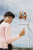 Young Girl Holding Toy Windmill — Stock Photo