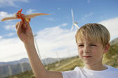 Boy Playing With Toy Glider At Wind Farm — Stock Photo