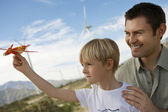 Boy Holding Toy Glider With Father — Stock Photo