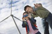 Girl Using Binoculars With Father At Wind Farm — Stock Photo