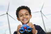 Boy Holding Binoculars At Wind Farm — Stock Photo