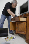 Burglar Looking Through Drawers In House — Stock Photo