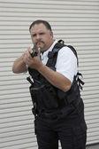 Security Guard In Bulletproof Vest Holding Gun — Stock Photo