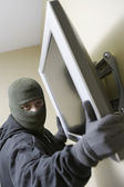 Thief Stealing Flat Screen Television — Stock Photo
