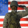 Photo: Soldier Saluting In Front Of American Flag