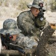 Soldiers With Machine Gun Leaning On Log — Stockfoto