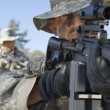 Soldiers Aiming Rifles In Field — Stockfoto
