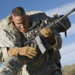 Stock Photo: US Army Soldier Carrying Wounded Colleague