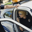 Police Officer Looking At Colleague — Stock Photo