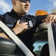 Stock Photo: Police Officer Using Two-Way Radio