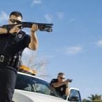 Police Officer Aiming Shotgun — Stock Photo #21800651