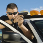 Police Officer Aiming Handgun — Stock Photo