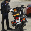 Traffic Cop Writing Against Motorcycle — Stock Photo #21801225