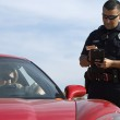 Traffic Cop By Sports Car — Stock Photo