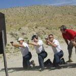 Four Firing Guns At Shooting Range — Stock Photo