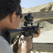 Stock Photo: MAiming Rifle At Firing Range