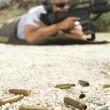Bullets On Ground With MAiming Machine Gun — Stock Photo #21801669