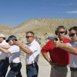 Foto Stock: Instructor Assisting Officers At Firing Range