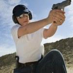 Woman Aiming Hand Gun At Firing Range — Stock Photo
