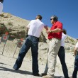 Instructor Assisting Aiming Guns At Firing Range — Foto de Stock