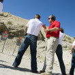 Instructor Assisting Aiming Guns At Firing Range — Stockfoto