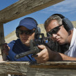 Instructor With Man Aiming Machine Gun — Foto de Stock