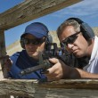 Instructor With Man Aiming Machine Gun — Stockfoto