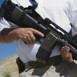 Stock Photo: MHolding Machine Gun At Firing Range